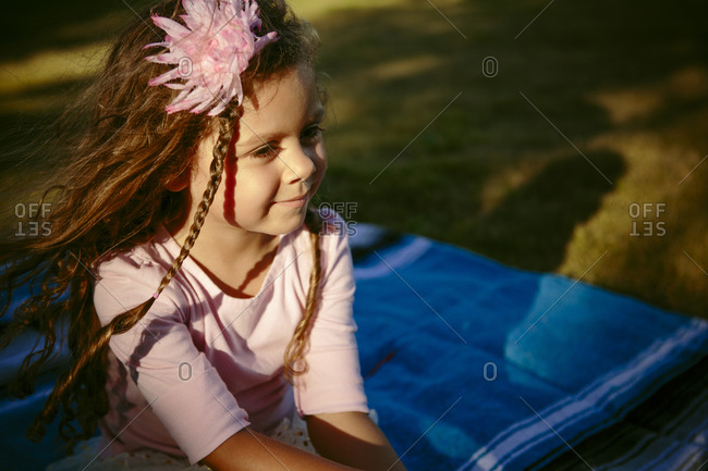 Girl on blanket with flower in hair