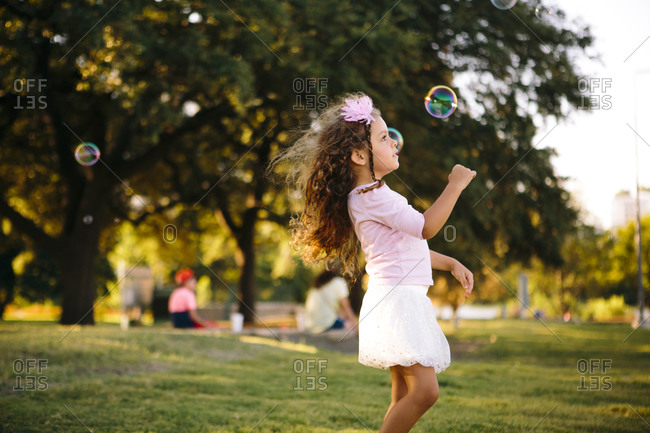 Girl looking at a floating bubble