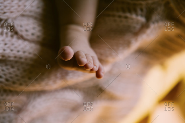 Close up of baby's foot on blanket