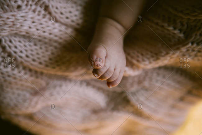 A baby's foot on blanket