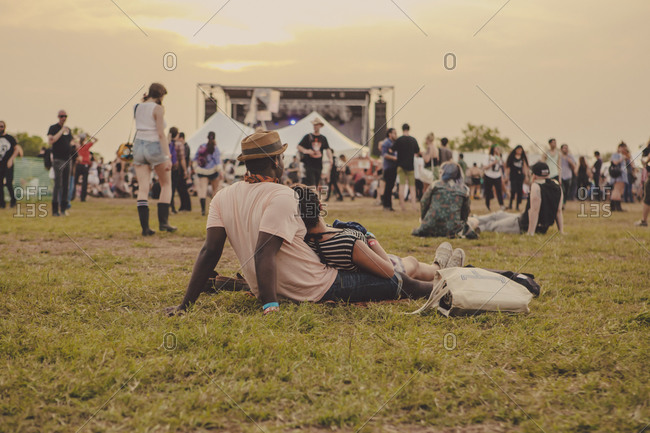 People relaxing in the grass at a music festival in Austin, Texas