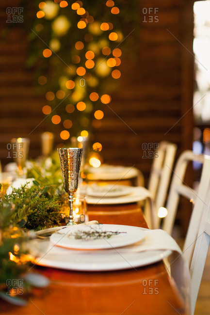 Selective focus of long wooden table set for wedding reception