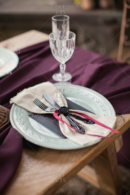 Close-up of a place setting on red cloth