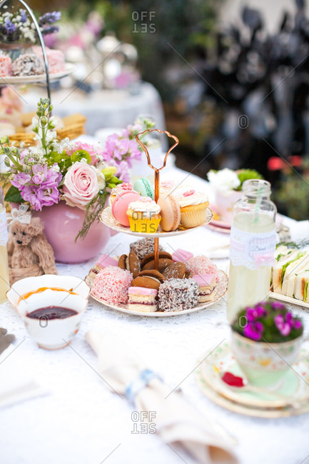 Tables set with sandwiches and pastries for a garden tea