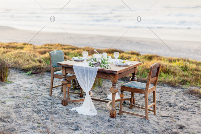Elegant table for two set on beach