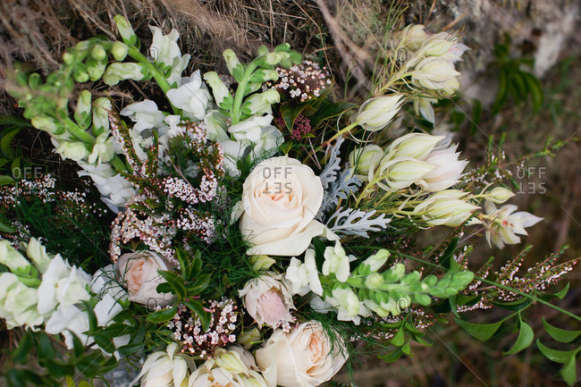 Close-up of rustic wedding bouquet of pale pink roses