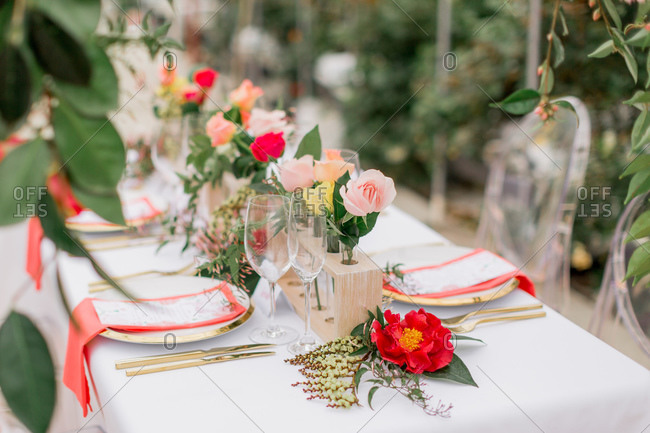 Coral and pink table decor at wedding reception