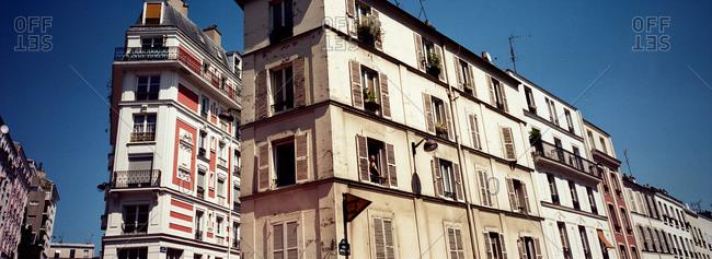 A traditional Parisian apartment block showing symmetrical architecture, Paris, France