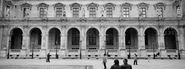 People walking in front of the Louvre Palace, Paris, France