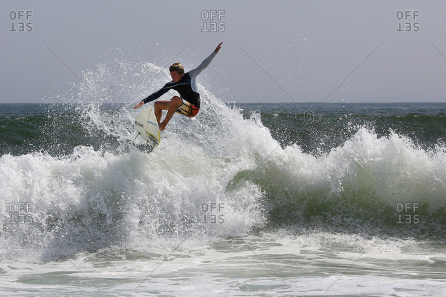 A surfer in action off the shore of Cisco Beach, Nantucket, Massachusetts