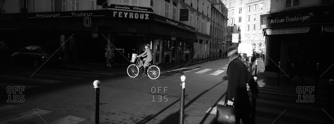 Early morning activity on the street corner of rue Juge and rue de Lourmel in  Paris, France