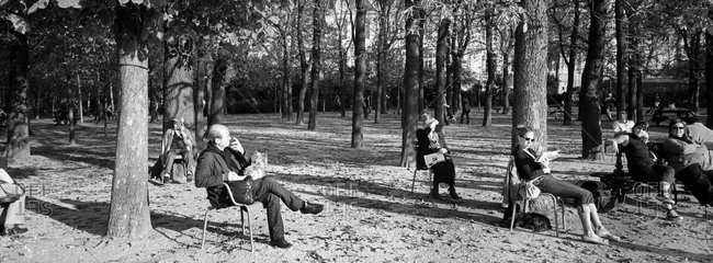 People relaxing in the Jardin du Luxembourg gardens in Paris, France
