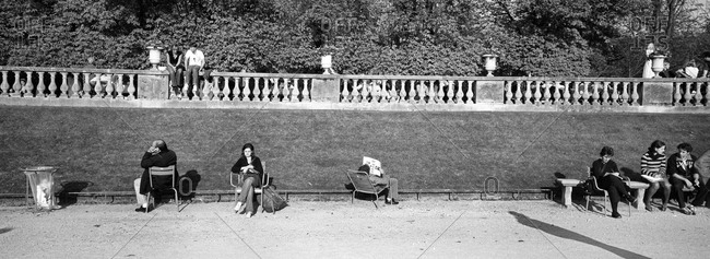 People lounging in the Jardin du Luxembourg in Paris, France