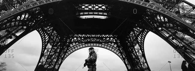 Army personnel guard The Eiffel Tower in Paris, France