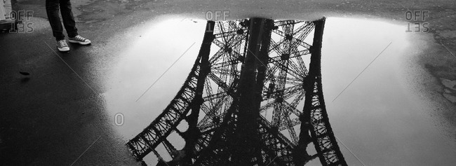 Reflection of the Eiffel Tower in a puddle, Paris, France