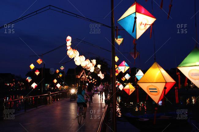 The lantern lit bridge at night time in Hoi An, Vietnam