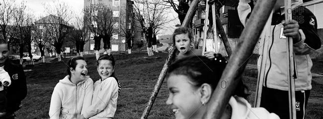 Copsa Mica, Transylvania, Romania - November 14, 2008: Children play outside of a housing estate in Copsa Mica, Transylvania, Romania