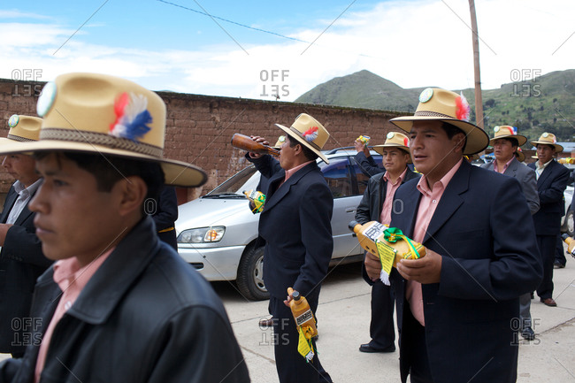 Copacabana, Bolivia - February 1, 2010: Men dressed in hat and suits at the festival of the Virgen de la Candelaria in Copacabana on the shores of Lake Titicaca