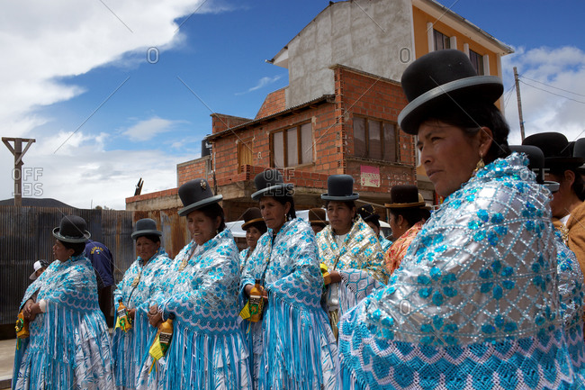 Copacabana, Bolivia - February 1, 2010: Women dressed in blue colorful costumes at the festival of the Virgen de la Candelaria in Copacabana on the shores of Lake Titicaca