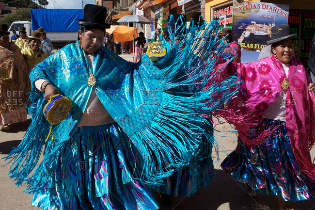 Copacabana, Bolivia - February 1, 2010: Women dressed in colorful costumes dancing at the festival of the Virgen de la Candelaria in Copacabana on the shores of Lake Titicaca