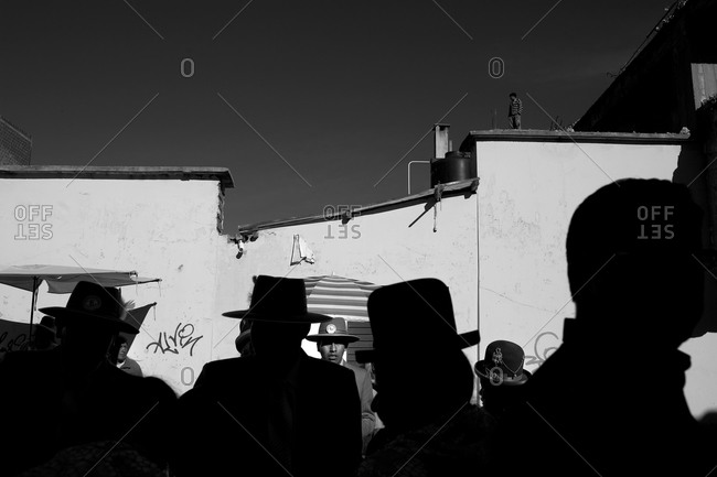 Copacabana, Bolivia - February 2, 2010: Silhouette of people dressed in costumes at the festival of the Virgen de la Candelaria in Copacabana on the shores of Lake Titicaca