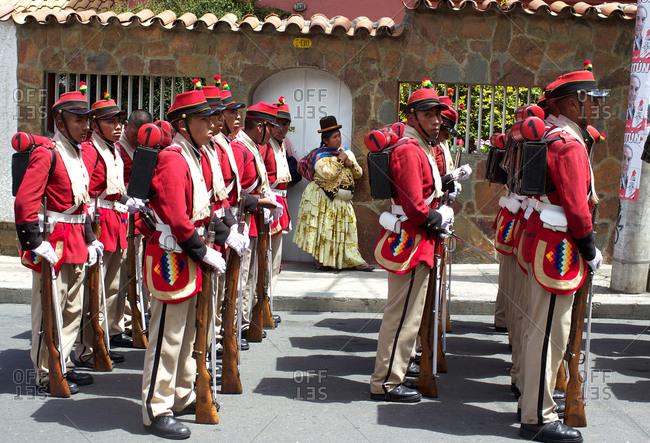 La Paz, Bolivia - March 23, 2010: Bolivian soldiers of the historic Colorados battalion participate in a military parade to honor national hero Eduardo Avaroa, Sopocachi, La Paz, Bolivia