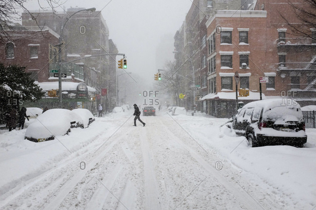 A city intersection blanketed in heavy snow