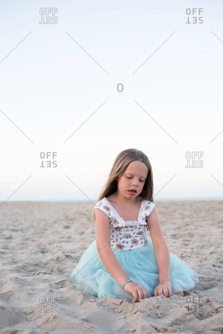 Young girl playing at the beach
