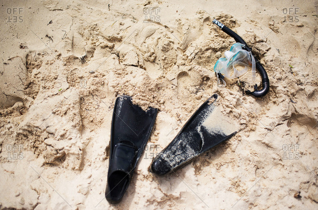 Overhead view of snorkel gear in the sand