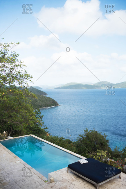 View of a swimming pool overlooking an ocean vista