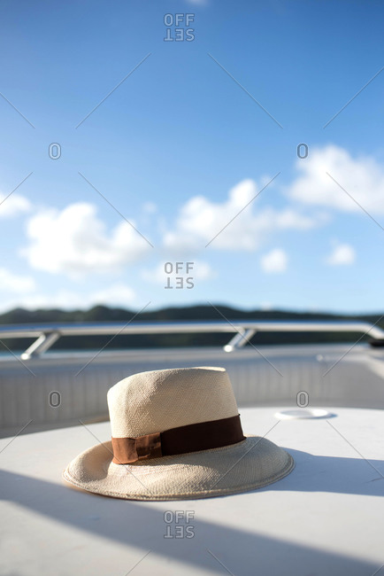Close-up of a brimmed hat sitting on the deck of a boat