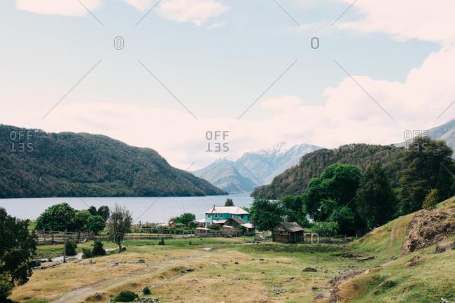 A small homestead along a mountainous lakeside