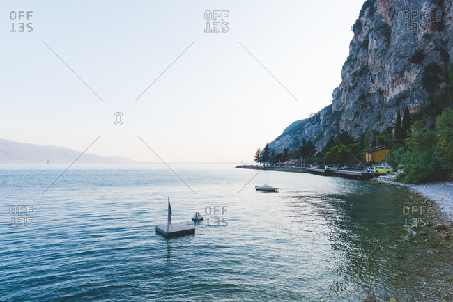 Boat and small platform in Lake Garda, Italy
