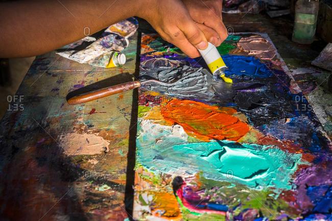 Close up of mid adult man creating artwork close-up