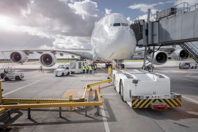 Ground crew operating loading equipment on an aircraft
