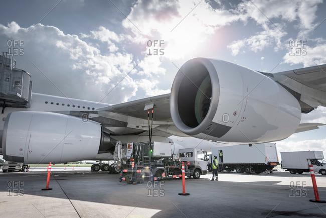 An aircraft being refueled at an airport