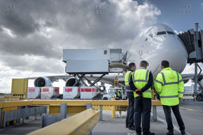 Ground crew inspecting an aircraft in an airport