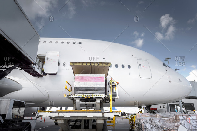 Ground crew loading freight into an aircraft