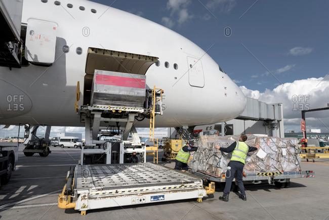 Ground crew loading freight off an aircraft