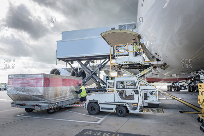 Ground crew loading freight into an airplane