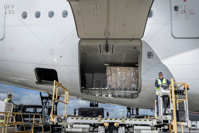 Ground crew loading an airplane at an airport