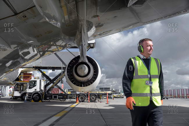 Ground crew engineer with an jet aircraft