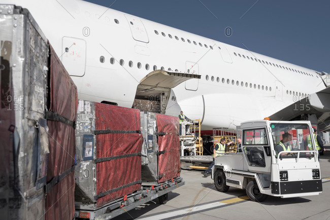 Ground crew loading an jet aircraft at an airport