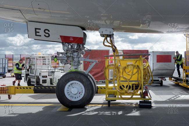 Ground crew loading luggage into an aircraft