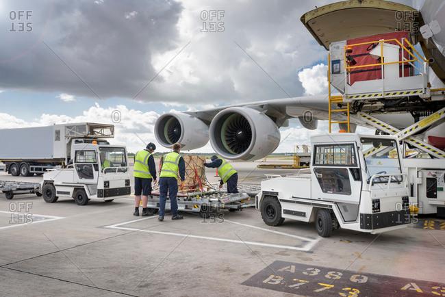 Ground crew loading freight onto an airplane