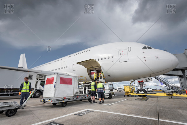 Ground crew loading freight onto an aircraft