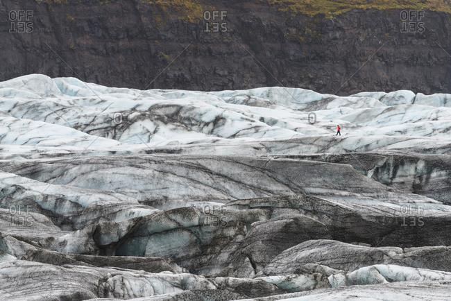 Distant hiker on Svinafellsjokull glacier, Iceland