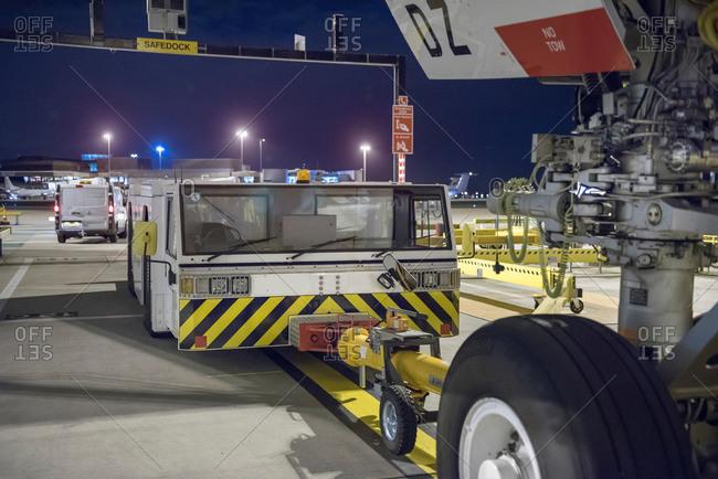 Tug for towing an aircraft on runway at night