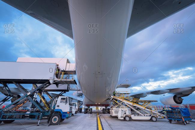 Ground crew unloading an aircraft at an airport