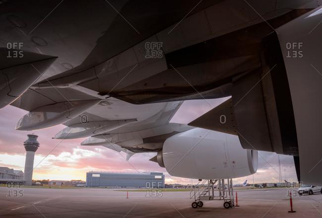 Detail of an aircraft at an airport at sunset